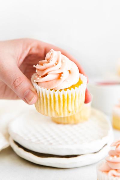 rhubarb cupcake being held up