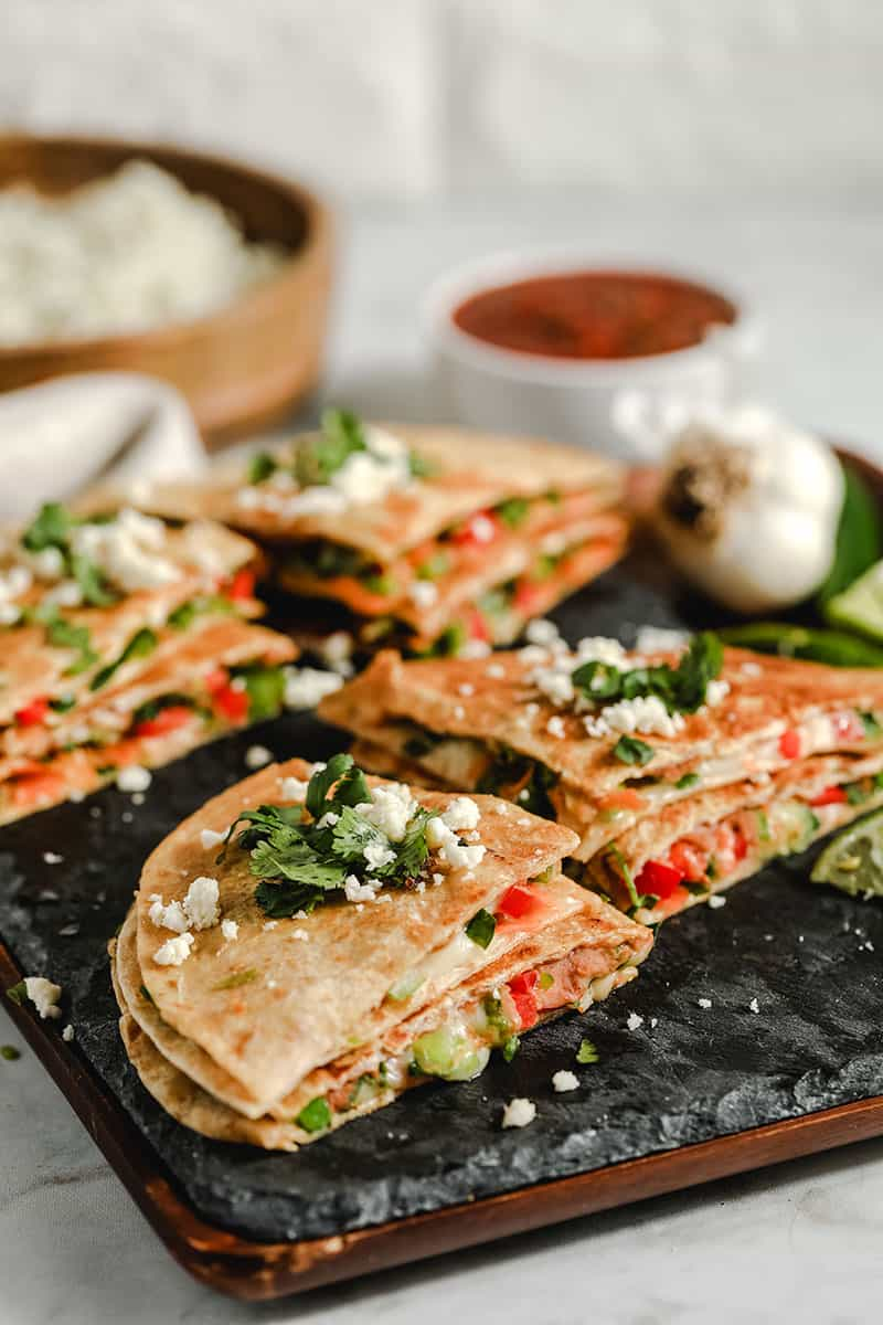 These vegetarian quesadillas are super quick and easy to make. Use whatever vegetables and cheese you have on hand for a delicious, (relatively) healthy meal.