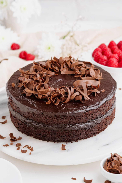 full healthy chocolate cake on cake stand