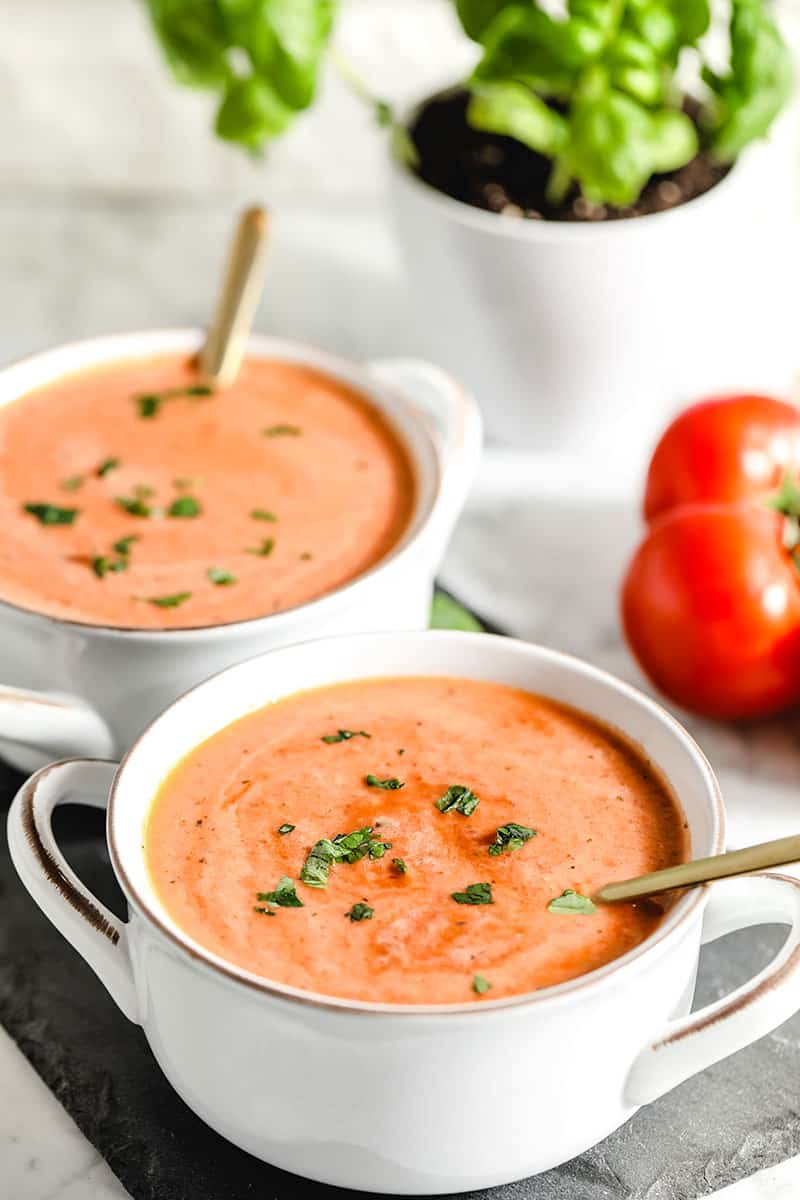This simple tomato soup recipe will become your go-to for a fast and delicious meal. With fresh or canned tomatoes, this soup can be on the table in less than 30 minutes and the flavor is incredible! You'll never go back to canned stuff after you try this easy homemade tomato soup. With paleo and vegan options.