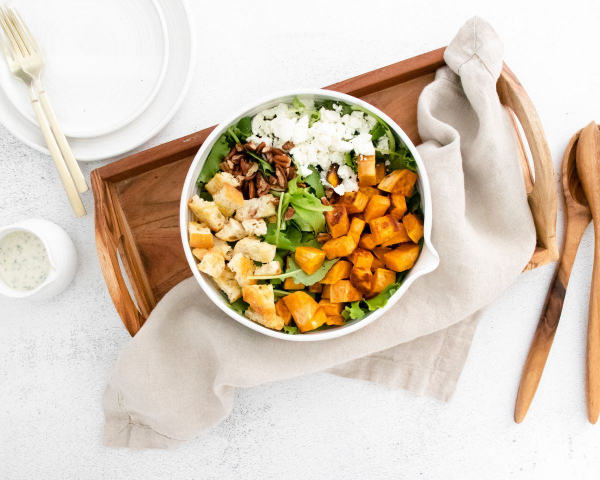 sweet potato goat cheese salad in bowl with napkin
