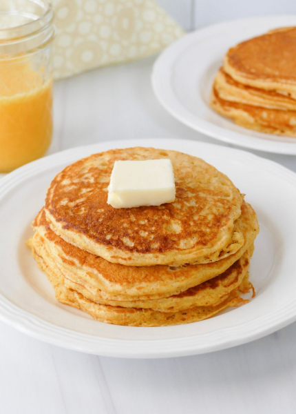 Cornmeal pancakes on plate