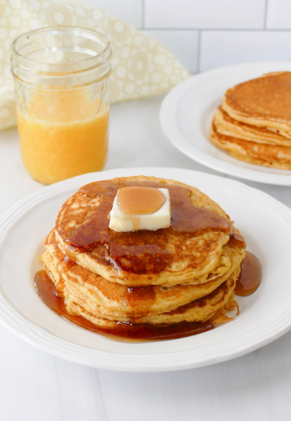 Cornmeal pancakes with syrup and butter