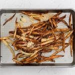 Air Fryer Garlic Fries on baking tray