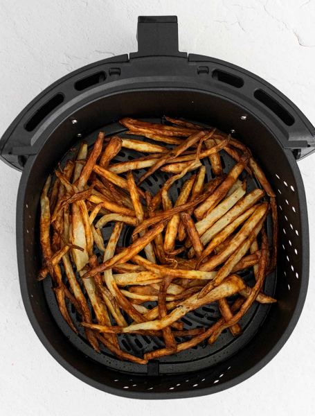 Air Fryer French Fries shown in the Air Fryer basket