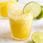 pineapple margarita being poured in glass
