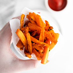 air fryer carrot fries in hand