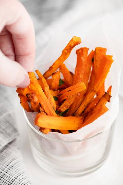 hand picking up air fryer carrot fries