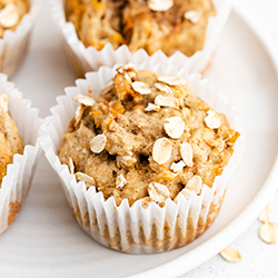 4 banana carrot muffins on plate