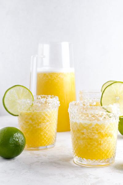 glasses of frozen pineapple margarita