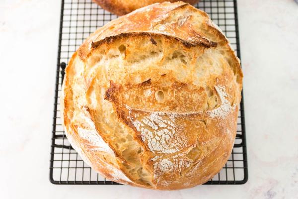 loaf of overnight sourdough on rack