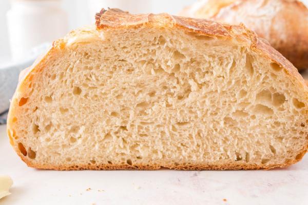 cut into loaf of sourdough