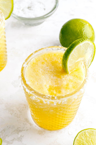 frozen pineapple margarita with lime on glass