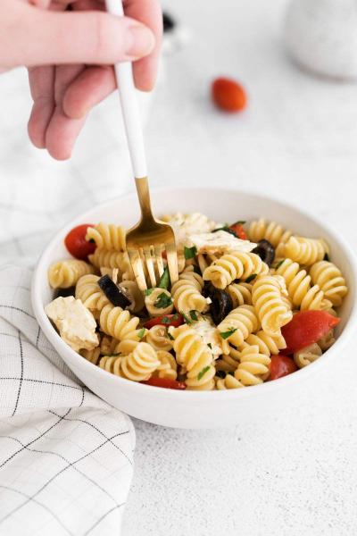 fork picking up some greek pasta salad