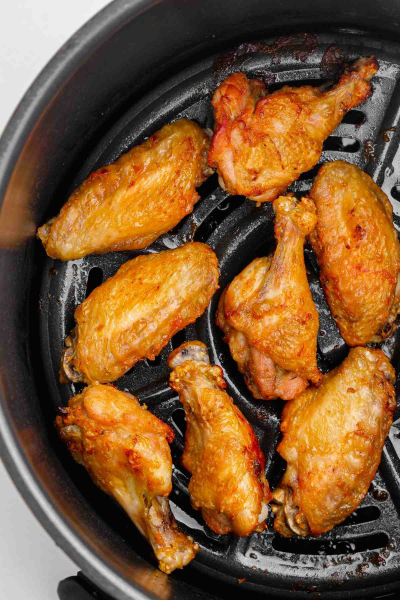 cooked wings inside air fryer basket