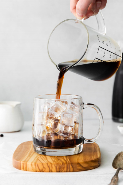 cold brew being poured into cup