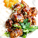 air fryer teriyaki chicken on plate with green onions and rice