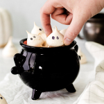 hand picking up ghost meringue