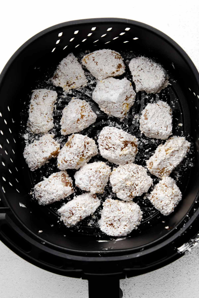 coated chicken chunks in air fryer basket